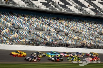 A.J. Allmendinger, Penske Racing Dodge and Kevin Harvick, Richard Childress Racing Chevrolet lead the field