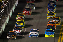 Denny Hamlin, Joe Gibbs Racing Toyota, Carl Edwards, Roush Fenway Racing Ford and Paul Menard, Richard Childress Racing Chevrolet go three-wide