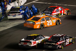 Greg Biffle, Roush Fenway Racing Ford and Kevin Harvick, Richard Childress Racing Chevrolet battle on pit road