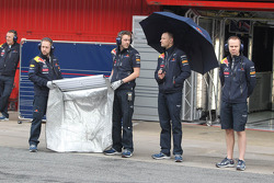 The Red Bull team wait for Sebastian Vettel, Red Bull Racing to return to the pits