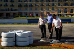 IMSA officials inspect the track