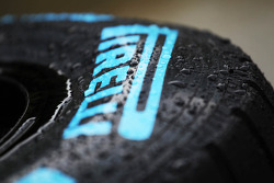 A wet Pirelli tyre coverred in rain drops