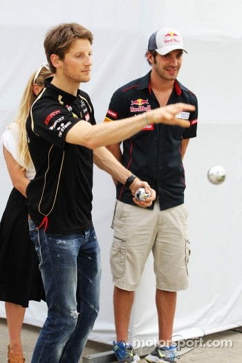 Romain Grosjean, Lotus F1 Team and Jean-Eric Vergne, Scuderia Toro Rosso play boules