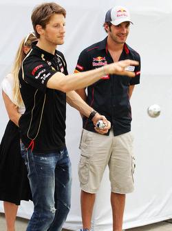 Romain Grosjean, Lotus F1 Team and Jean-Eric Vergne, Scuderia Toro Rosso play boules