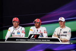 The qualifying top 3 FIA Press Conference Jenson Button, McLaren Mercedes; pole sitter Lewis Hamilton, McLaren Mercedes and Michael Schumacher, Mercedes GP