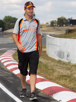 Jamie Whincup walks the track