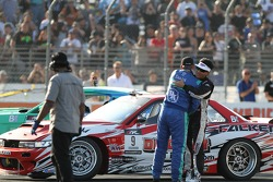 Justin Pawlak hugs Daijiro Yoshihara