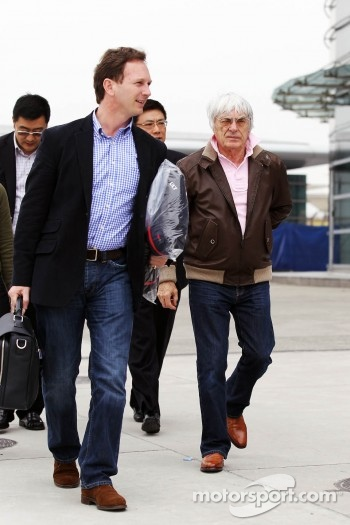 Christian Horner, Red Bull Racing Team Principal in the paddock with Bernie Ecclestone, CEO Formula One Group