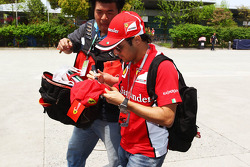 Felipe Massa, Scuderia Ferrari signs autographs for the fans