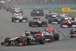 Romain Grosjean, Lotus F1 leads Lewis Hamilton, McLaren at the start of the race