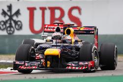 Sebastian Vettel, Red Bull Racing leads Jenson Button, McLaren