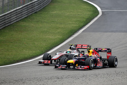 Lewis Hamilton, McLaren and Mark Webber, Red Bull Racing battle for position