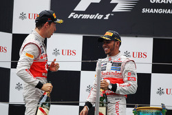 Podium: second place Jenson Button, McLaren, third place Lewis Hamilton, McLaren