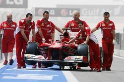Ferrari pushed down the pit lane