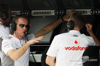 Sam Michael, McLaren Mercedes Sporting Director with Martin Whitmarsh, McLaren Mercedes Chief Executive Officer on the pit gantry