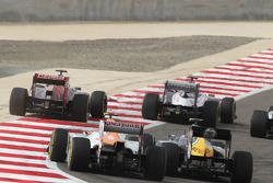 Daniel Ricciardo, Scuderia Toro Rosso and Pastor Maldonado, Williams leads Nico Hulkenberg, Sahara Force India F1 and Vitaly Petrov, Caterham