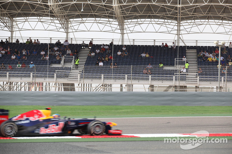 Sebastian Vettel, Red Bull Racing passing an empty grandstand