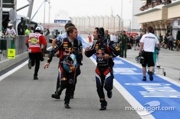 Race winner Sebastian Vettel, Red Bull Racing runs to parc ferme as he stopped at the end of the race