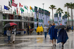 Heavy rain falls on the paddock during the qualifying session