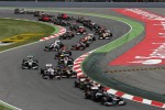 Pastor Maldonado, Williams leads Romain Grosjean, Lotus F1 at the start of the race