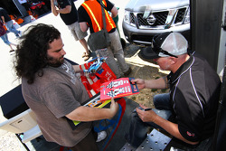 Paul Tracy greets serious race fans during autograph signing