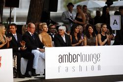 HSH Prince Albert of Monaco, with Princess Charlene of Monaco and Bernie Ecclestone, CEO Formula One Group, with Fabiana Flosi, at the Amber Lounge Fashion Show