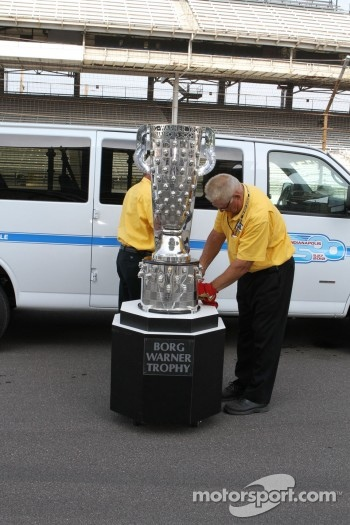 The Borg Warner Trophy is secured onto the base