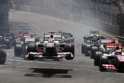 Kamui Kobayashi, Sauber flies through the air at the start of the race as he crashed with Romain Grosjean, Lotus F1