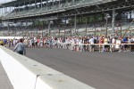 Fans file across the track on race morning