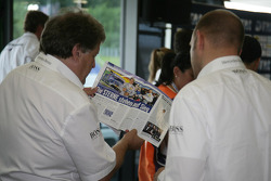 Norbert Haug, Sporting Director Mercedes-Benz is reading a magazin
