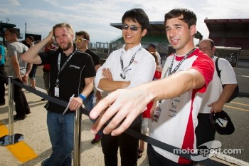 Nick Heidfeld and Neel Jani check out the Toyota Racing Toyota TS 030 - Hybrid