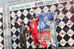 Race winner Scott Dixon, second place Dario Franchitti, third place Simon Pagenaud