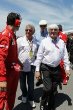 Bernie Ecclestone, CEO Formula One Group, on the grid with Mario Andretti