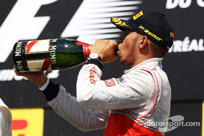 Race winner Lewis Hamilton, McLaren Mercedes celebrates on the podium