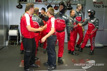 Audi Sport team members celebrate pole position