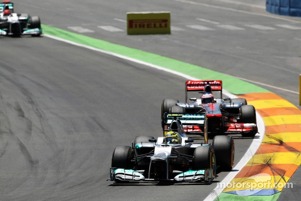 Nico Rosberg, Mercedes AMG F1 leads Jenson Button, McLaren Mercedes