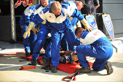 Medical extraction team practice on a Red Bull Racing mechanic