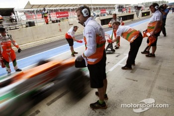 Sahara Force India F1 Team mechanics in the pits