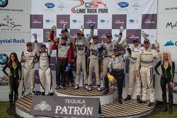 Overall winners podium. P1 Lucas Luhr, Klaus Graf; P2 Scott Tucker, Christophe Bouchut; GT Jörg Bergmeister, Patrick Long; PC Jonathan Bennett, Colin Braun; GTC Cooper MacNeil, Leh Keen