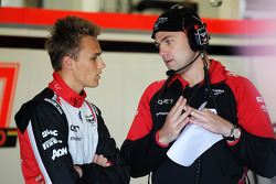 Max Chilton, Marussia F1 Team Test Driver, with an engineer