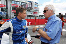 Bernd Maylander, FIA Safety Car Driver with Charlie Whiting, FIA Delegate on the grid