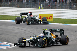 Vitaly Petrov, Caterham leads team mate Heikki Kovalainen, Caterham