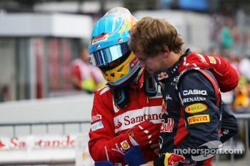 Race winner Fernando Alonso, Ferrari celebrates in parc ferme with Sebastian Vettel, Red Bull Racing