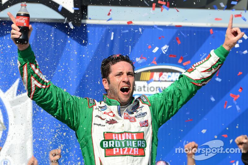 Victory lane: race winner Elliott Sadler celebrates