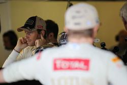 Romain Grosjean, Lotus F1 Team with Kimi Raikkonen, Lotus F1 Team in the foreground