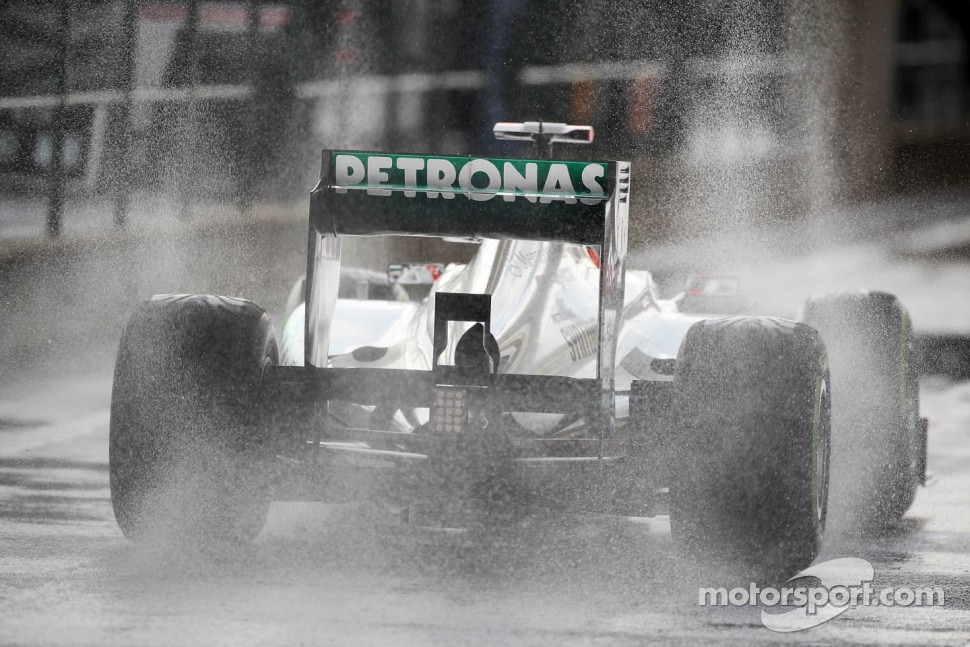 Michael Schumacher, Mercedes AMG F1 leaves the pits in the wet
