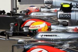 Pole sitter Lewis Hamilton, McLaren  and team mate Jenson Button, McLaren  in parc ferme