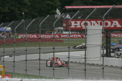 Scott Dixon takes the checked flags