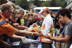 Nico Hulkenberg, Sahara Force India F1 and Sergio Perez, Sauber sign autographs for the fans