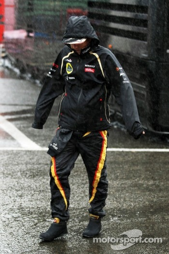 Kimi Raikkonen, Lotus F1 Team during a heavy rain shower